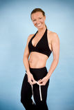 Healthy woman. Taking her body measurments Royalty Free Stock Photo