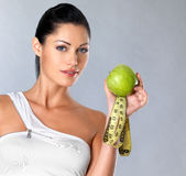 Healthy woman with apple Royalty Free Stock Photos