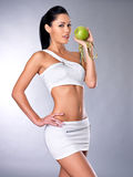 Healthy woman with apple Stock Images