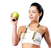 Healthy woman with apple and bottle of water Royalty Free Stock Photography