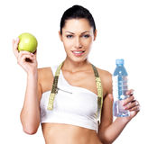 Healthy woman with apple and bottle of water Stock Photo