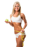 Healthy woman with apple and measuring tape Royalty Free Stock Images