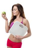 Healthy woman with an apple and scales. Stock Photo