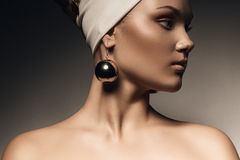 Healthy woman with big earrings Stock Photography