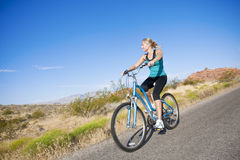 Healthy Woman on a bike ride Royalty Free Stock Image