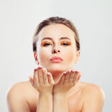 Healthy Woman with Clear Skin Blowing Kiss Stock Photos