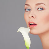 Healthy Woman with Clear Skin and Lily Royalty Free Stock Photos