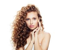 Healthy woman with clear skin and perfect curly hair stock images