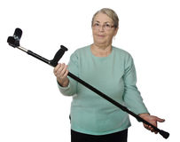 Healthy woman with crutch Stock Photos