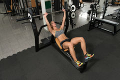 Healthy Woman Doing Bench Press Exercise For Chest Stock Images