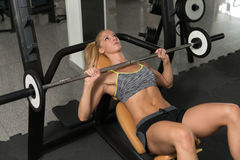 Healthy Woman Doing Bench Press Exercise For Chest Stock Photo