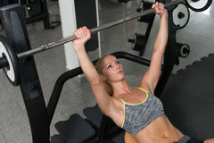 Healthy Woman Doing Bench Press Exercise For Chest Royalty Free Stock Photo