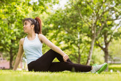 Healthy woman doing stretching exercises in park Royalty Free Stock Photos