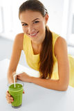Healthy Woman  Drinking Green Detox Juice. Lifestyle, Food, Drin Stock Images