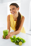 Healthy Woman  Drinking Green Detox Juice. Lifestyle, Food, Drin Stock Image