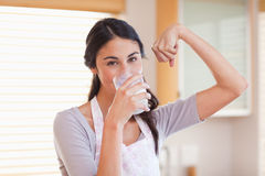 Healthy woman drinking milk Stock Photography
