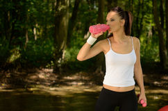 Healthy woman drinks in park Royalty Free Stock Image