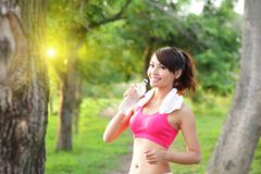 Healthy woman drinks water. Doing sport outdoor, fitness, diet & body care concept Stock Photos