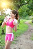 Healthy woman drinks water. Doing sport outdoor, fitness, diet & body care concept Royalty Free Stock Images