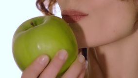 Healthy woman eating an apple stock footage