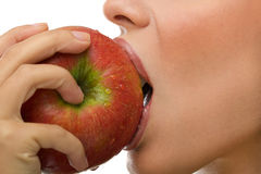 Healthy woman eating apple royalty free stock photo