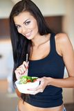 Healthy woman eating a fresh mixed salad Stock Photography
