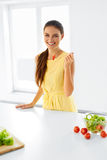 Healthy Woman Eating Organic Vegetarian Food. Lifestyle, Diet Co Stock Photography