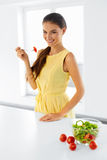 Healthy Woman Eating Organic Vegetarian Food. Lifestyle, Diet Co Stock Photos