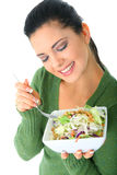 Healthy Woman Eating Salad. Happy young woman eating her salad. healthy lifestyle royalty free stock image