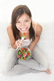 Healthy woman eating salad royalty free stock photos