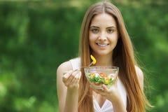 Healthy woman eating salad Stock Photography
