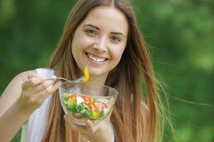 Healthy woman eating salad Stock Photos
