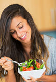 Healthy woman eating salad Stock Images
