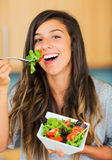 Healthy woman eating salad Stock Photo