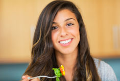 Healthy woman eating salad Stock Photos