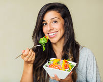 Healthy woman eating salad Royalty Free Stock Images