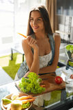 Healthy Woman Eating Vegetables In Kitchen. Weight Loss Diet Stock Image