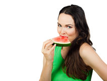 Healthy woman eating water melon. A healthy young beautiful woman eating a juicy water melon. Isolated on white royalty free stock image