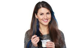 Healthy woman eating yoghurt Stock Images