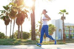 Healthy woman exercising outdoors Royalty Free Stock Images