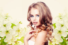 Healthy Woman Fashion Model on Spring Flowers Stock Photo