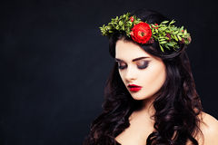 Healthy Woman with Flowers Wreath on Dark Royalty Free Stock Photography