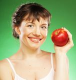 Healthy woman with fresh red apple Royalty Free Stock Image