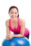 Healthy woman - girl smiling and leaning fitness ball isolated o Stock Photo