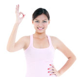 Healthy Woman Giving OK gesture Stock Images