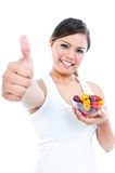 Healthy Woman Giving Thumb Up And Bowl Of Fruits Stock Photo