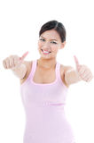 Healthy Woman Giving Two Thumbs Up Stock Photo
