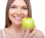 Healthy woman with green apple Stock Image