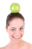 Healthy woman with green apple winking Stock Image