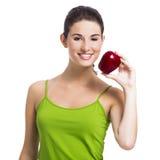 Healthy woman holding an apple Stock Photos